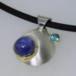 Sterling Silver and Yellow Gold Orbit Pendant with Tanzanite and Blue Zircon - Dyke Vandenburgh Jewelers