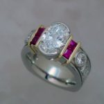 Two Tone Ring with Oval Diamond and Princess Cut Rubies - Dyke Vandenburgh Jewelers